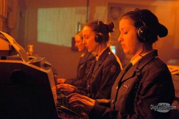 Military radio operators in a red room