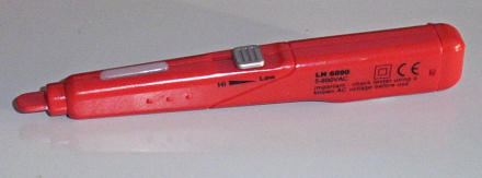 A red, pen-like electrical-signal scanner.