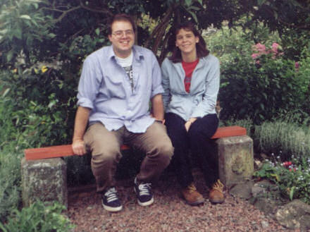 Gareth and Jane sitting on a garden bench