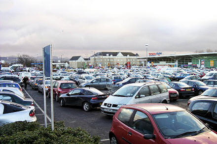 Photograph of queue of cars at a standstill in Tesco car park