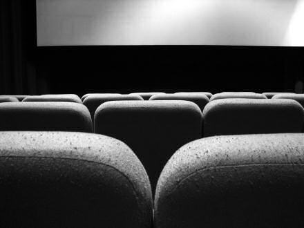 Inside of a cinema, showing seats and a screen