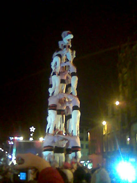 Catalan acrobats creating a six-level human pyramid