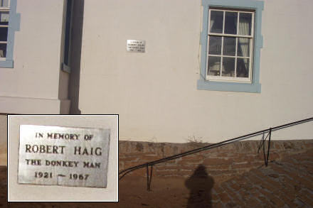 A plaque on the wall, commemorating the Donkey Man