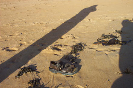 A lone sandal on the beach at Elie