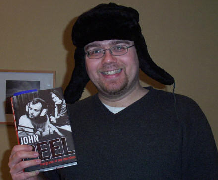Gareth wearing a Russian hat, holding a copy of John Peel\'s book