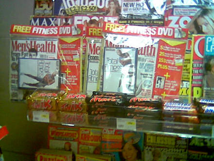 Confectionery display in front of Men\'s Health magazines!
