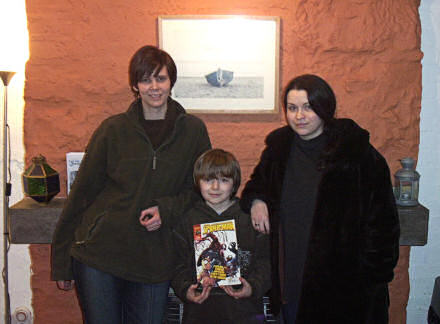 Jane, Benjamin and Jenni standing in front of the fireplace in our house in Cellardyke.