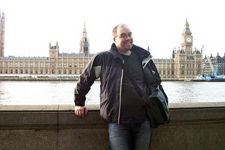 Gareth standing across the River Thames from the Houses of Parliament in London