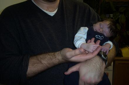 Baby Owen asleep in Gareth\'s arms