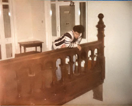 Andy Williamson leaning over a bannister at Darley Dale School, Derbyshire
