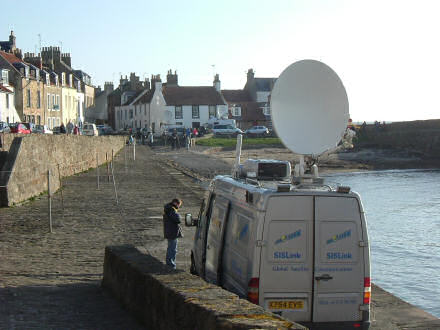 View of Cellardyke harbour, looking towards the slipway, with a TV van in the way.