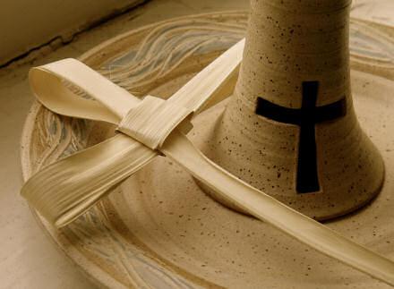 Palm cross lying on a patten.