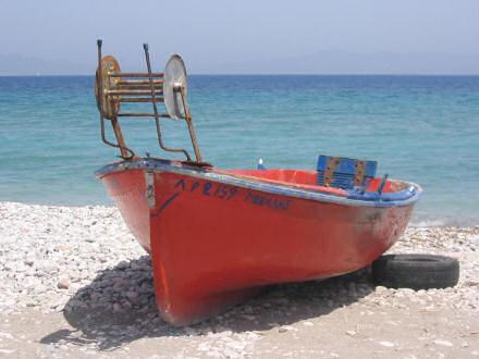 Red, Greek fishing boat.
