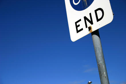 A sign saying End, against a deep blue sky