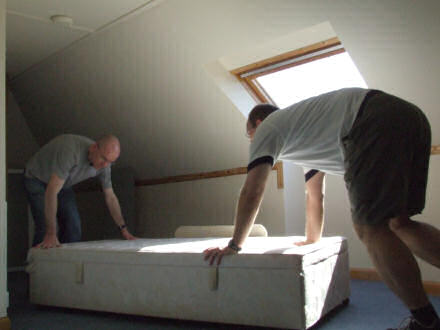 Martin and Gareth moving a bed.