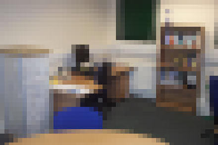 A pixelated photograph of Steve's desk.