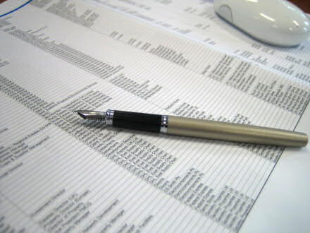 A computer printed list with a pen lying on top.