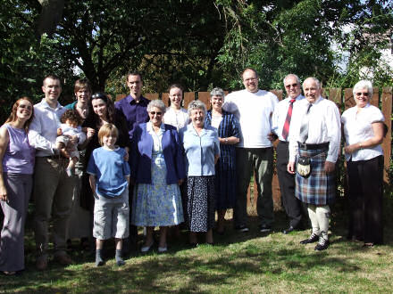 Family and friends in the garden after the baptism of Owen.