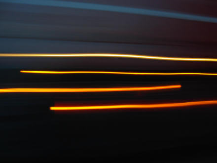 Coloured lights from passing cars.