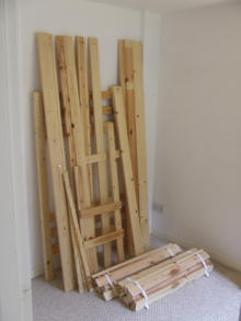 A pile of wood (that could be a bunk bed)