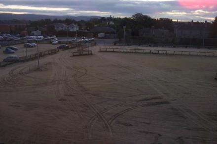 View from my hotel room -- of a sandy field.