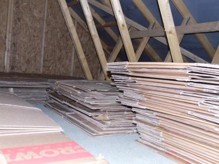 Flattened cartons in an attic