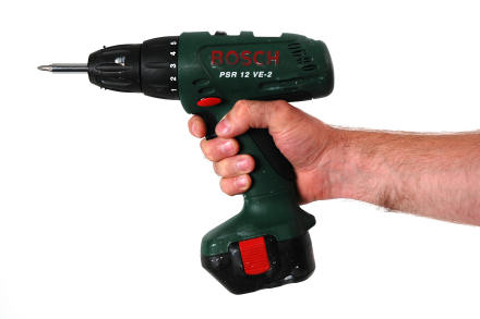 Someone holding a Bosch electric drill