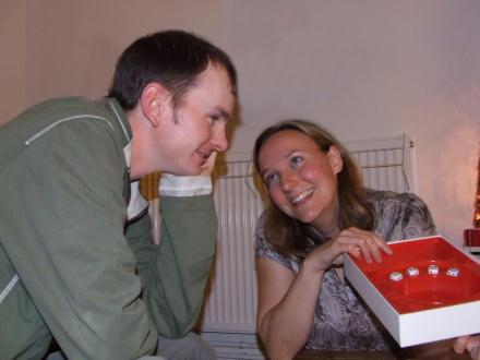 Yvonne shows Ian her third Yahtzee