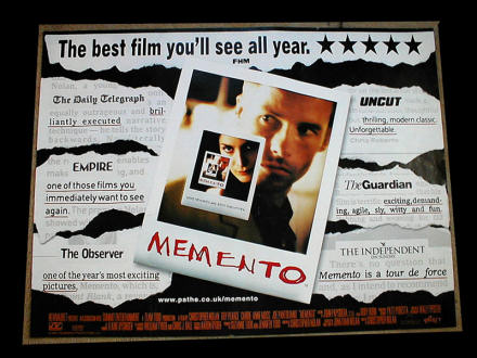Poster for the movie Memento shows a photo within a photo within a photo ... you get the idea. It is surrounded with press clippings.