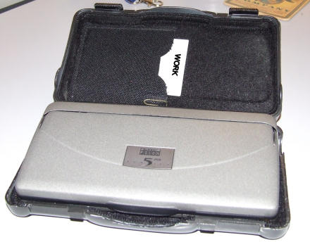 Open Psion case showing a card that says WORK.