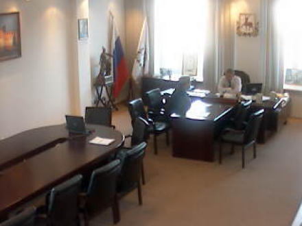 Two men in a government office somewhere in Russia.