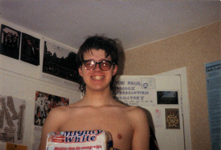 Gareth in 1990, with NHS specs and a loaf of Mighty White