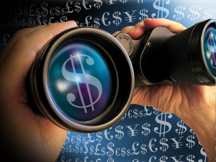 Dollar signs on the lens of a pair of binoculars.