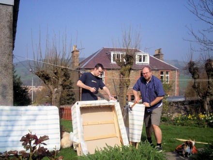 Eddie and Gareth breaking up a bed in the garden.
