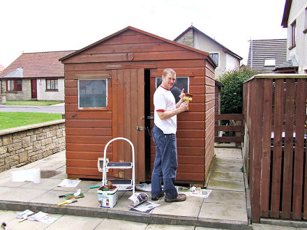 Richard painting the shed.