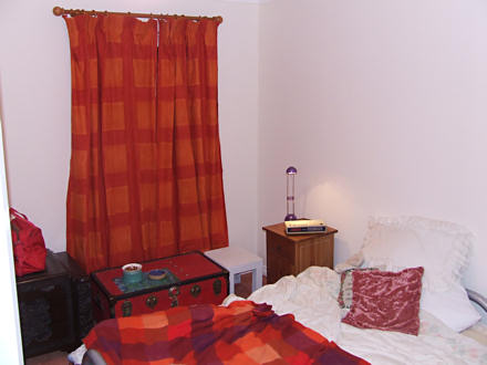 Bedroom with orange curtains