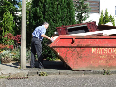 Peter putting stuff in the skip