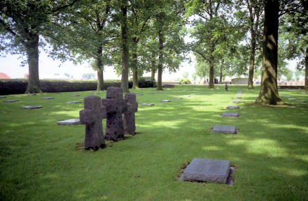 German military cemetery in Belgium, shaded beneath trees