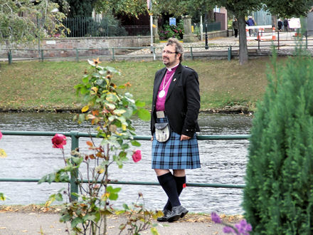 Bishop Mark standing beside the River Ness