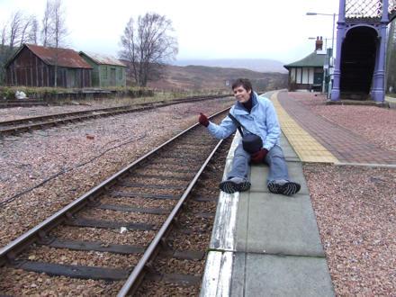 Jane hitching on a railway station platform