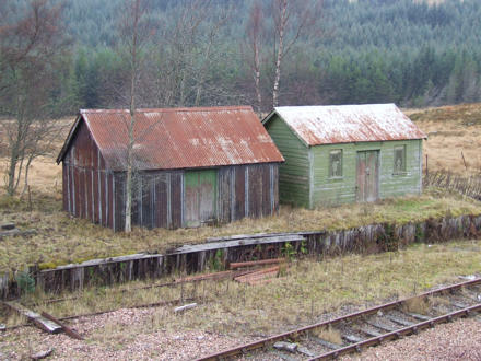 Huts by the side of a railway line