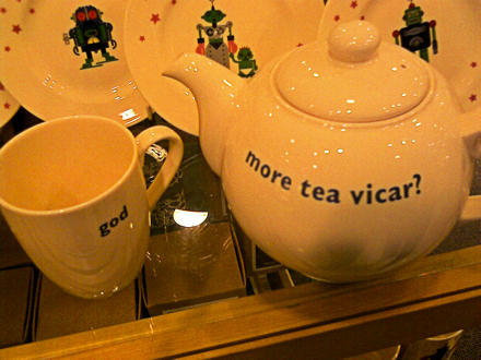 Teapot with More Tea Vicar on it, next to a mug saying God