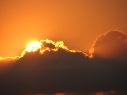Sun behind clouds