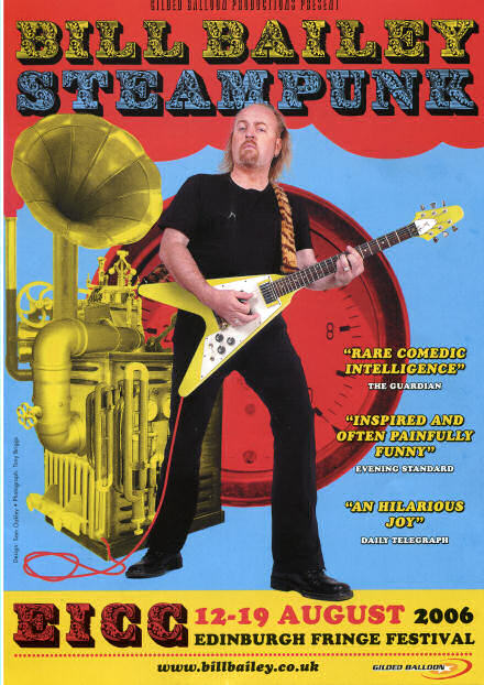 Programme cover for Bill Bailey's Steampunk show - Bill stands in front of a machine playing guitar.