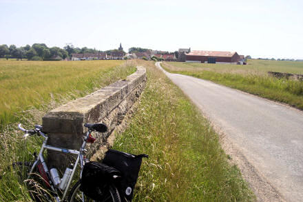My bike propped against a bridge, with Kilrenny in the background.