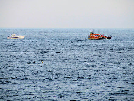 Zoomed photo of a lifeboat at sea.
