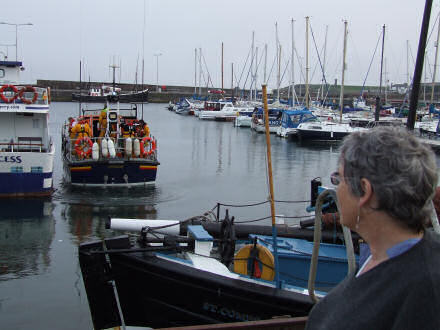 My Mum looking at the lifeboat in the harbour.