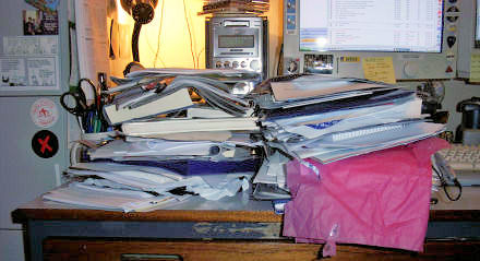 Two piles of paperwork on my desk