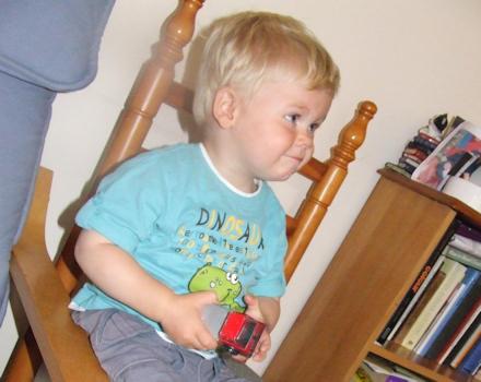 Joshua sitting on a chair