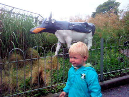 Joshua beside the Penguin Cow sculpture at Edinburgh Zoo